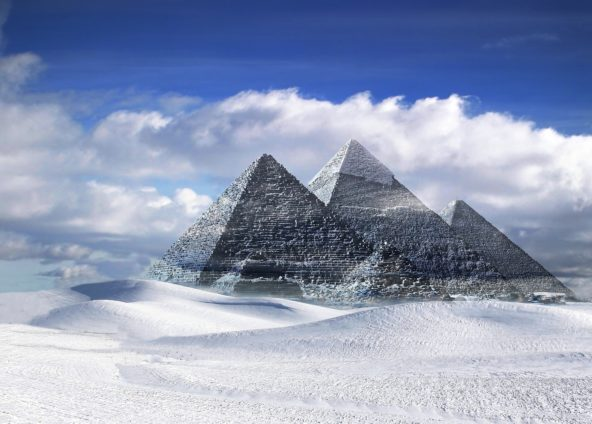 global warming scenarios: pyramids in white sand